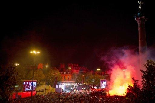 Tens of thousands of Hollande supporters partied into the night in Bastille Square