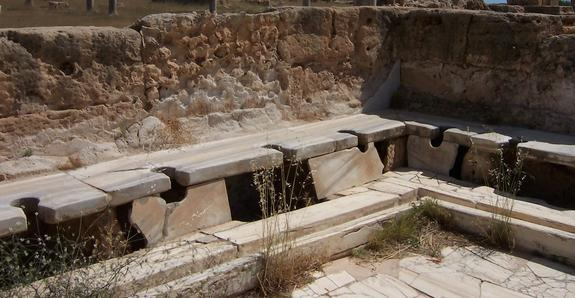 The remains of Roman latrines in Leptis Magna, Libya.