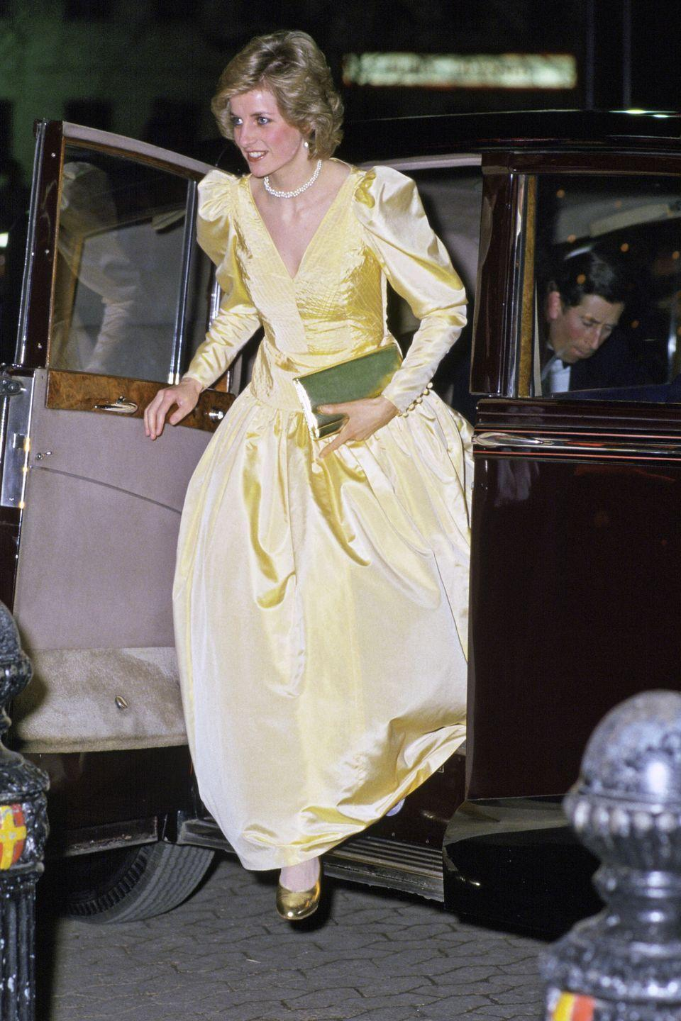 <p>Princess Diana looked absolutely radiant arriving at a London film premiere in a satin ball gown designed by Murray Arbeid in 1985. From the pale yellow color to the full skirt silhouette, the Princess looked just like Belle.</p>