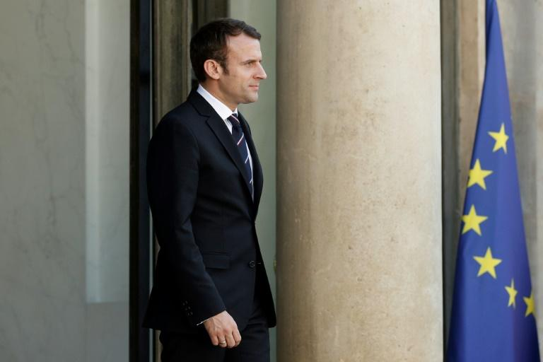 French president names mix of faces to left-right government
