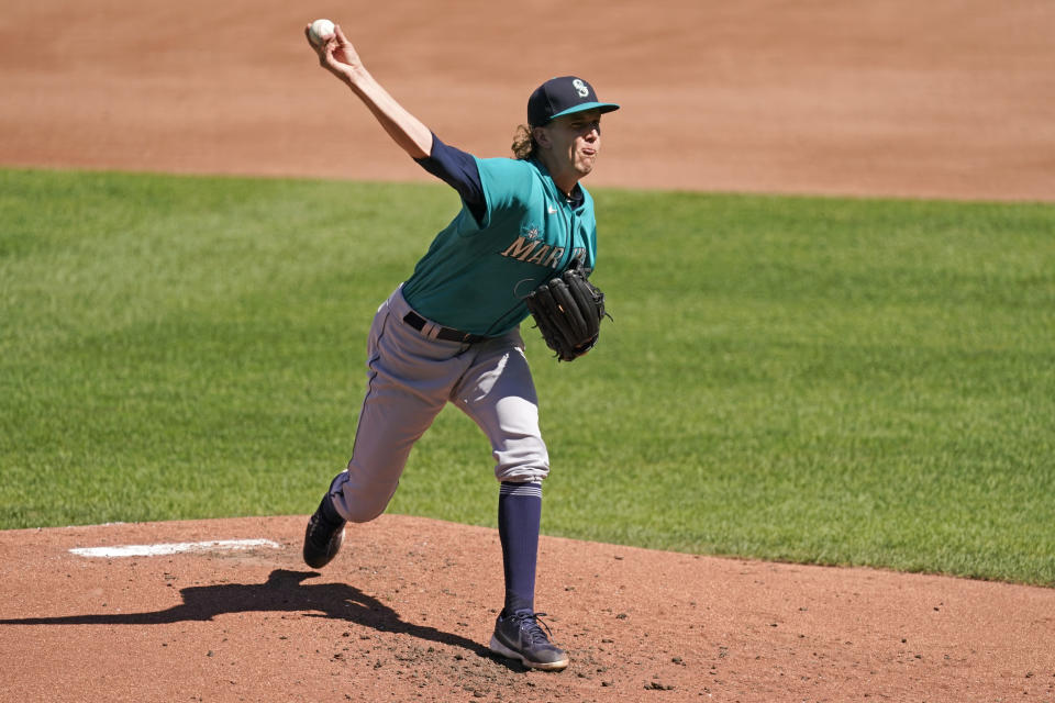 Seattle Mariners starting pitcher Logan Gilbert throws during the second inning of a baseball game against the Kansas City Royals Sunday, Sept. 19, 2021, in Kansas City, Mo. (AP Photo/Charlie Riedel)