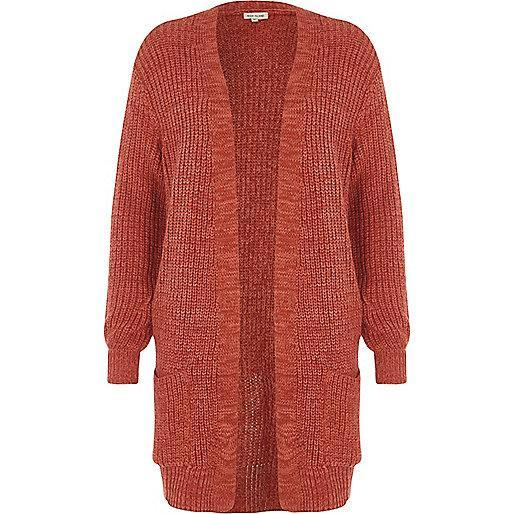 """<p>When shopping for autumnal pieces, make sure to keep an eye out for pumpkin hues. We cannot wait to purchase this slouchy knit this season. <em><a rel=""""nofollow noopener"""" href=""""https://www.riverisland.com/p/petite-dark-pink-ribbed-knit-cardigan-701386"""" target=""""_blank"""" data-ylk=""""slk:River Island"""" class=""""link rapid-noclick-resp"""">River Island</a>, £36</em> </p>"""