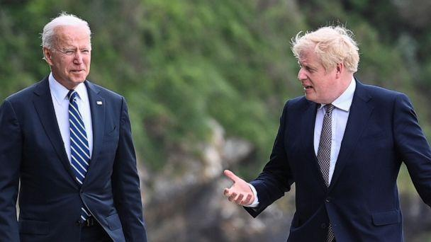 PHOTO: Britain's Prime Minister Boris Johnson speaks with U.S. President Joe Biden while they walk outside Carbis Bay Hotel, Carbis Bay, Cornwall, Britain, June 10, 2021. (Toby Melville/Reuters)