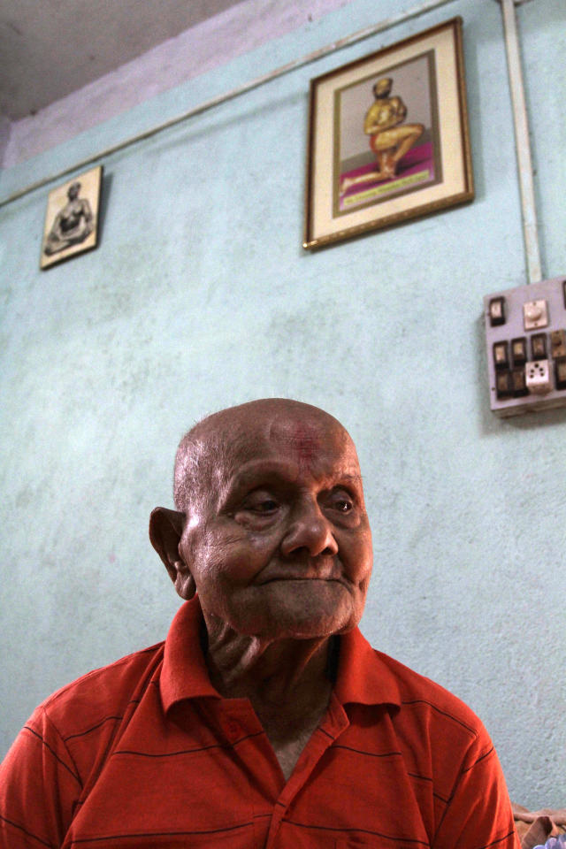 Indian body builder Manohar Aich looks on at his residence in Kolkata, India, Sunday, March 18, 2012. Aich, who is only 4 foot 11 inches (150 centimeters) tall, won the Mr. Universe title in London way back in 1952. Happiness and a life without tensions are the key to his longevity, said Aich, who turned 100 on March 17. (AP Photo/Bikas Das)
