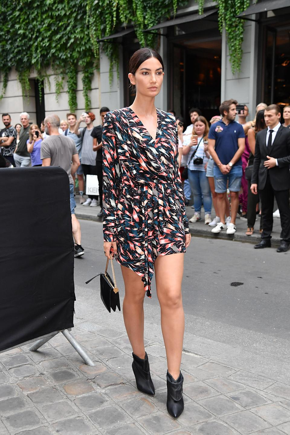 <p>On 1 July, Lily Aldridge arrived for the Givenchy haute couture show in a chic wrap-around dress by the French label. <em>[Photo: Getty]</em> </p>
