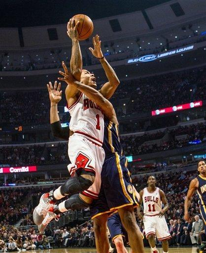 Chicago Bulls' Derrick Rose goes to the basket as Indiana Pacers' David West defends during the first quarter of an NBA basketball game in Chicago on Monday, March 5, 2012. (AP Photo/Charles Cherney)