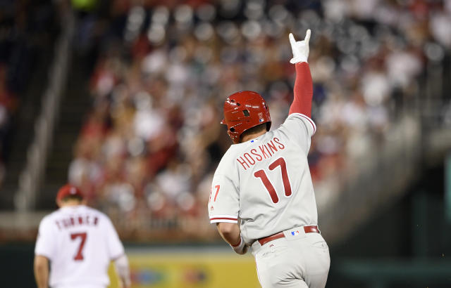 Philadelphia Phillies' Rhys Hoskins gestures as he rounds the base after his two-run home run during the third inning of a baseball game against the Washington Nationals, Sunday, June 24, 2018, in Washington. Also seen is Nationals shortstop Trea Turner (7). (AP Photo/Nick Wass)