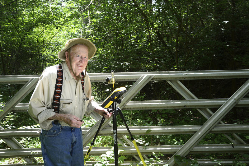 """This Aug. 2, 2016 photo provided by Indiana Department of Natural Resources shows Bob Vollmer.  Vollmer, 102, who is Indiana's oldest state employee is retiring after nearly six decades on the job, saying that """"your body tells you when it's time to go.""""  Vollmer plans to report to work for the last time Feb. 6, 2020, as a surveyor for the Indiana Department of Natural Resources. The southern Indiana man, whose mother lived to be 108, joined the state agency in 1962.  (John Maxwell/ Indiana Department of Natural Resources via AP)"""