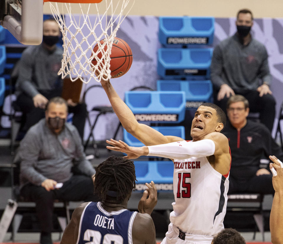 Texas Tech guard Kevin McCullar (15) goes to the basket to score with a layup during the second half of a first round game against Utah State in the NCAA men's college basketball tournament, Friday, March 19, 2021, at Assembly Hall in Bloomington, Ind. (AP Photo/Doug McSchooler)