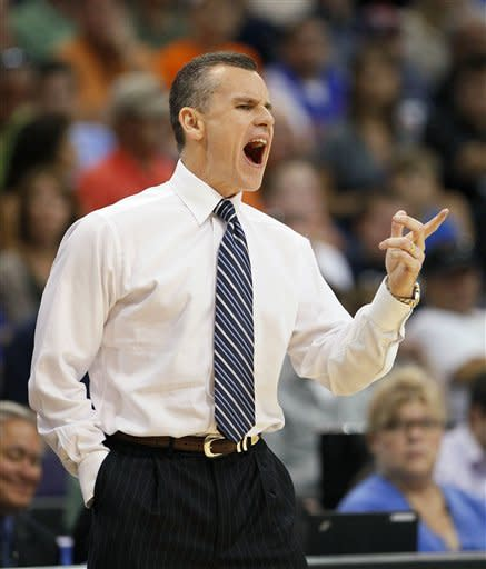 Florida head coach Billy Donovan reacts during the first half of an NCAA tournament West Regional final college basketball game against Louisville, Saturday, March 24, 2012, in Phoenix. (AP Photo/Matt York)