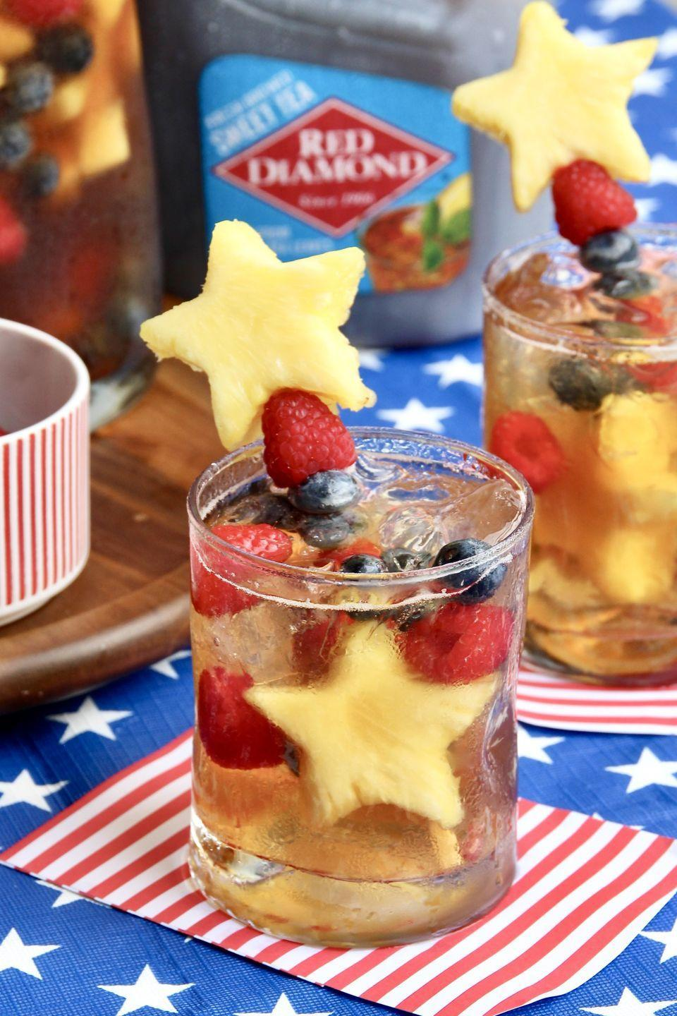 """<p>Sweet tea gets an adult-friendly upgrade, thanks to orange liqueur and sparkling wine. Festive fruit kebabs make the beverage perfect for your Fourth of July crowd, too. </p><p>Get the recipe at <a href=""""https://thebakermama.com/recipes/sparkling-sweet-tea-sangria/"""" rel=""""nofollow noopener"""" target=""""_blank"""" data-ylk=""""slk:The Baker Mama"""" class=""""link rapid-noclick-resp"""">The Baker Mama</a>. </p>"""