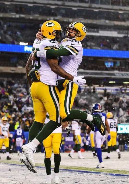 Green Bay quarterback Aaron Rodgers and teammate Marcedes Lewis celebrate a touchdown in the Packers' 31-13 NFL victory over the New York Giants (AFP Photo/Emilee Chinn)