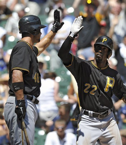 Pittsburgh Pirates' Garrett Jones, left, congratulates Andrew McCutchen (22) after McCutchens' solo home run against the Milwaukee Brewers during the fourth inning of a baseball game, Sunday, July 15, 2012, in Milwaukee. (AP Photo/Jim Prisching)