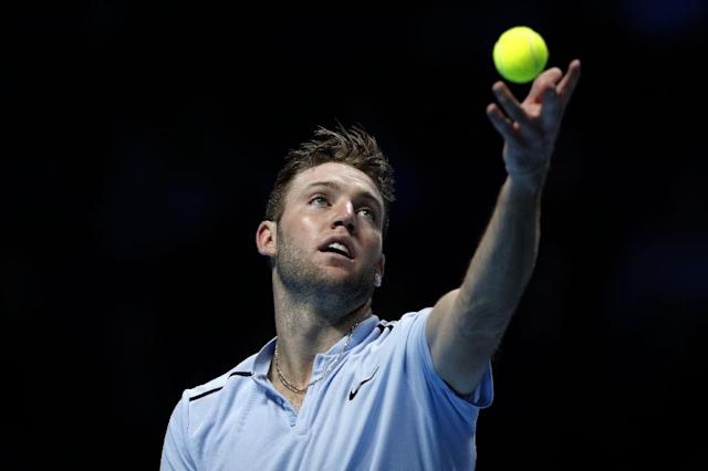 US Jack Sock serves to Switzerland's Roger Federer during their men's singles match at the ATP World Tour Finals at the O2 Arena in London on November 12, 2017 (AFP Photo/Adrian DENNIS)
