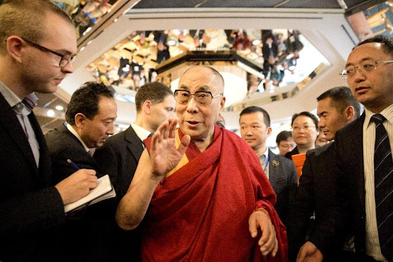 Tibetan spiritual leader Dalai Lama talks with journalists at a Sino-Tibetan conference in Hamburg, northern Germany, on August 27, 2014