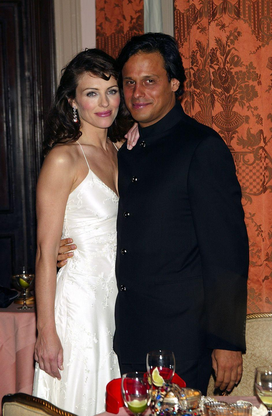 <p>In late 2002, Elizabeth started dating Indian textile heir Arun Nayar. Here they are at the Breast Cancer Research Foundation's Annual Spring Gala at the Waldorf-Astoria Hotel in 2003 with him.</p>