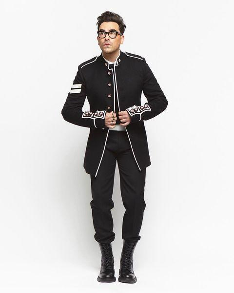 <p>shows off his trendsetter status in a military-inspired Dior suit and boots, plus Cartier jewelry. </p>