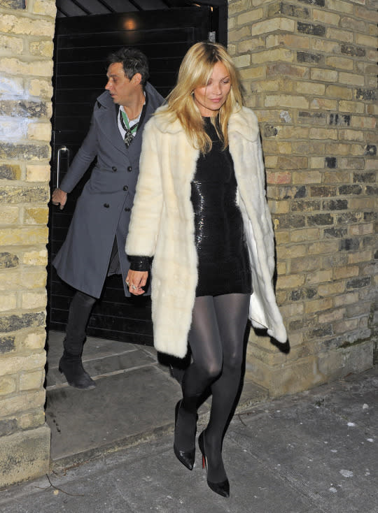 Kate Moss wears Christian Louboutins on her 38th birthday, 2012  Is that a red heel we see? It sure is! Moss paired her sequin dress and white fur coat with black Louboutin heels on her 38th. Despite the sequins, the model enjoyed a low-key dinner with her husband and friends in London.