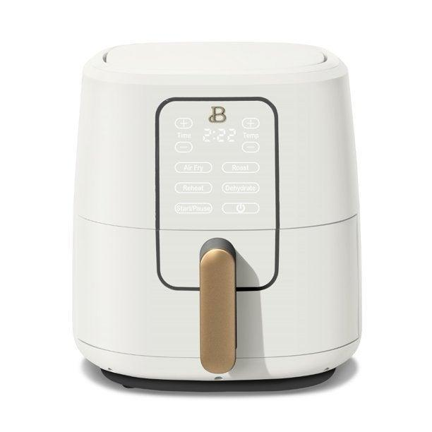 "<h2>Beautiful Air Fryer</h2><br>""I was a little bit intimidated by this air fryer when I first unboxed it, and it took me a few days to actually put it to use. When I finally did make my (gluten-free) chicken tenders, I was in awe of how easy it was and how perfectly it cooked the chicken. It was honestly so delicious, I was ready to be on an episode of <em>Top Chef. </em>In the days since, this air fryer has earned permanent counter space. It's also really sleek looking, and doesn't disrupt the flow of my kitchen too much. I'm excited to try out new recipes in it!"" —<em>Leora Yashari, Senior News Editor</em><br><br><strong>Beautiful</strong> Beautiful 6 Quart Touchscreen Air Fryer, White Icing by Drew Barrymore, $, available at <a href=""https://go.skimresources.com/?id=30283X879131&url=https%3A%2F%2Fwww.walmart.com%2Fip%2FBeautiful-6-Quart-Touchscreen-Air-Fryer-White-Icing-by-Drew-Barrymore%2F597932797"" rel=""nofollow noopener"" target=""_blank"" data-ylk=""slk:Walmart"" class=""link rapid-noclick-resp"">Walmart</a>"
