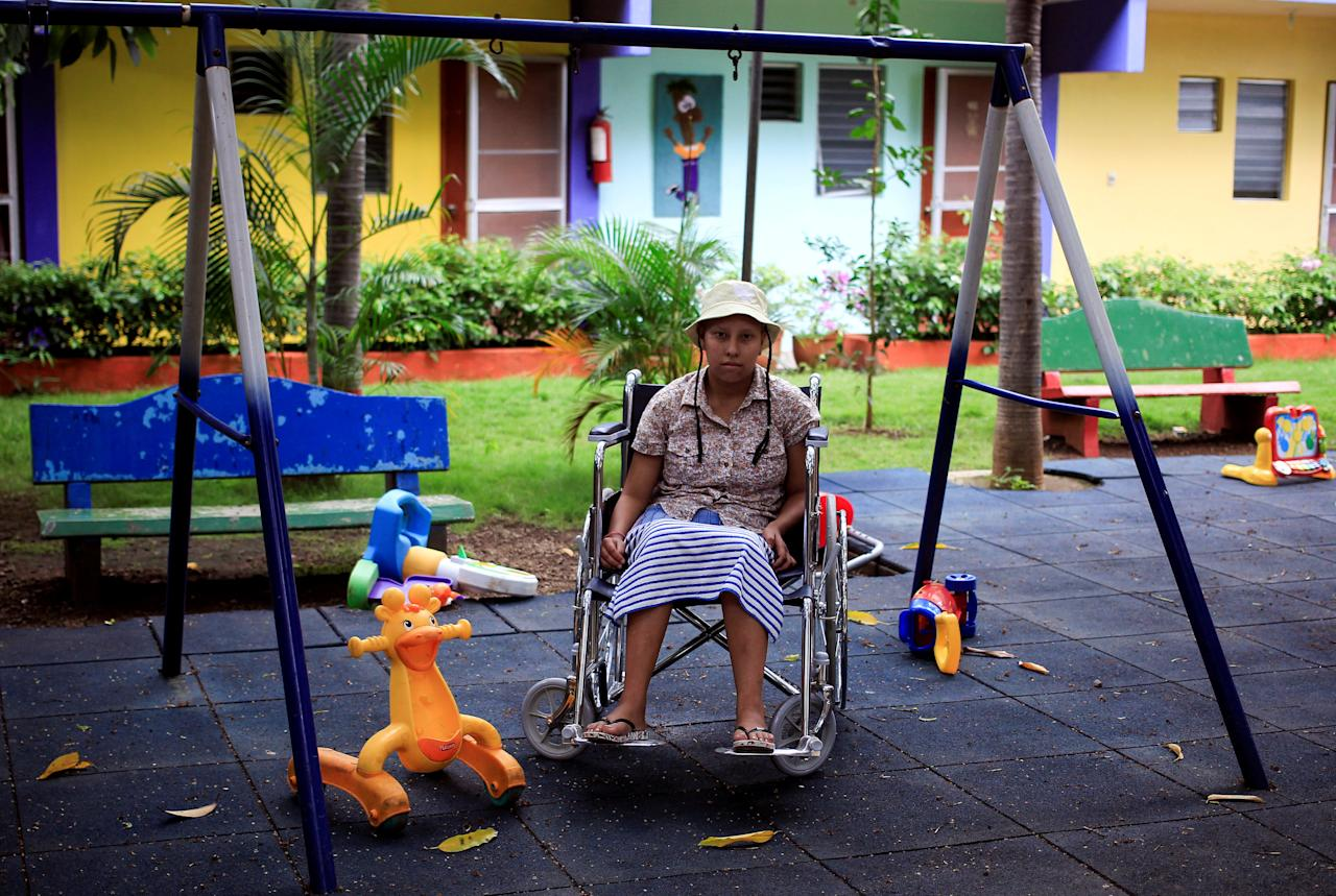 REFILE - CORRECTING DATE  Norma del Carme Blandin, a cancer patient sits in her wheelchair in the garden of Casa-Albergue at the La Mascota children's hospital in Managua, Nicaragua October 20, 2017. Picture taken October 20, 2017. REUTERS/Oswaldo Rivas