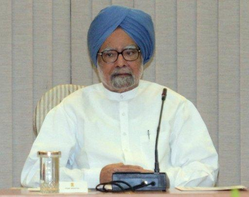 """Indian PM Manmohan Singh has said the economic """"gloom and doom"""" clouding the country in recent years has been dispelled"""