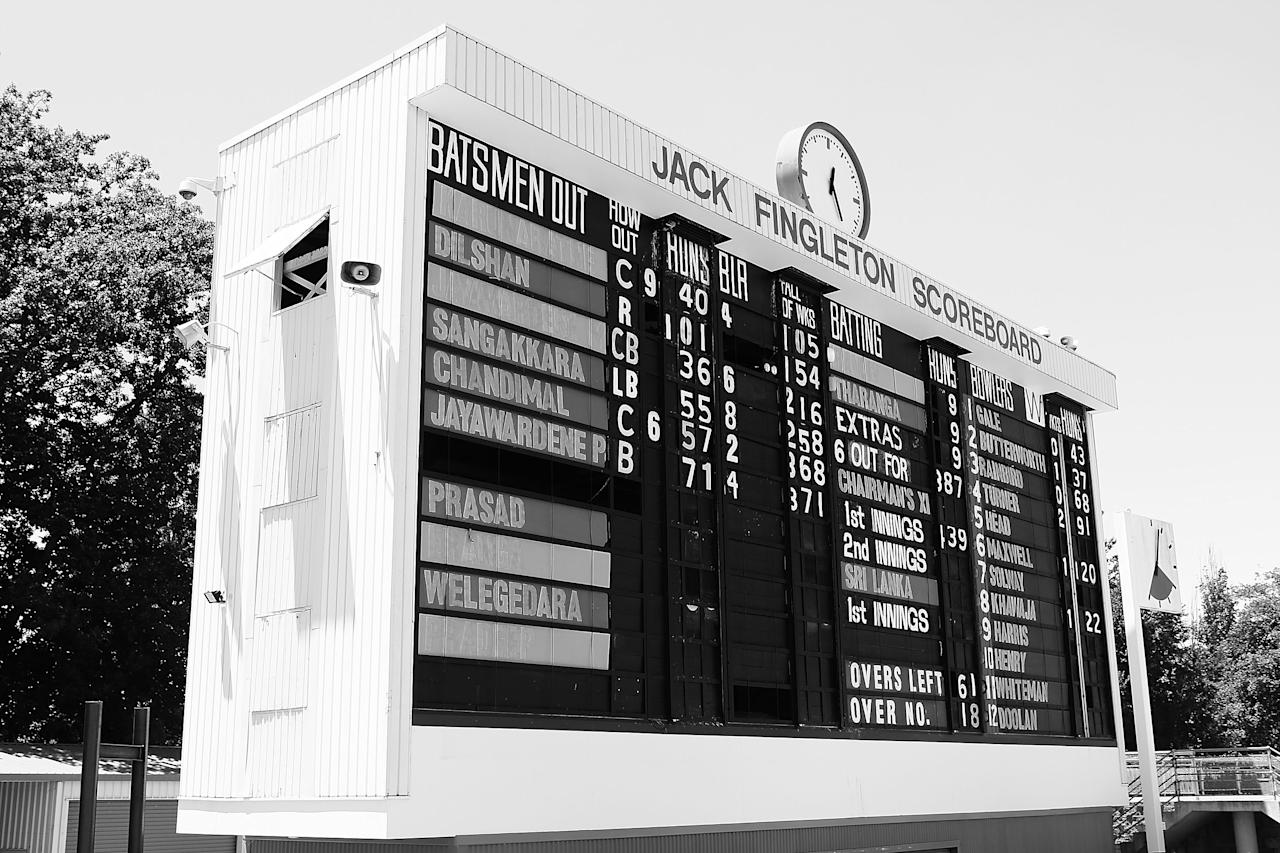 CANBERRA, AUSTRALIA - DECEMBER 08:  (EDITORS NOTE: Images has been converted to Black & White) The Jack Fingleton Scoreboard displays the score during an international tour match between the Chairman's XI and Sri Lanka at Manuka Oval on December 8, 2012 in Canberra, Australia. The Jack Fingleton Scoreboard was first erected at the MCG in 1901. In 1982 it was replaced by an electronic board and donated to the Manuka Oval by the Melbourne Cricket Club as memorial to J.H.W Fingleton OBE.  (Photo by Brendon Thorne/Getty Images)