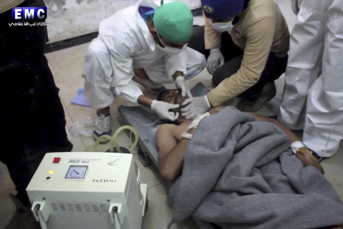 <p>This frame grab from video provided on Tuesday April 4, 2017, by the Syrian anti-government activist group Edlib Media Center, that is consistent with independent AP reporting, shows a victim of a suspected chemical attack as he receives treatment at a makeshift hospital, in the town of Khan Sheikhoun, northern Idlib province, Syria. The suspected chemical attack killed dozens of people on Tuesday, Syrian opposition activists said, describing the attack as among the worst in the country's six-year civil war. (Edlib Media Center, via AP) </p>