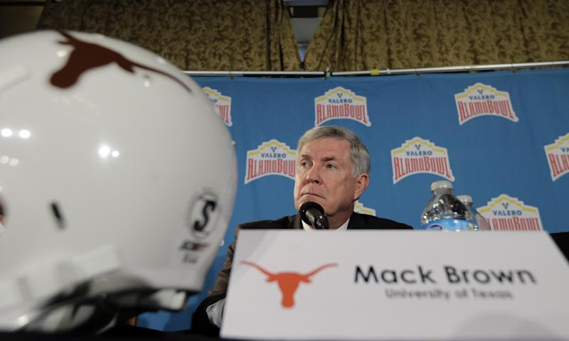 Texas coach Mack Brown listens to a question during a Valero Alamo Bowl NCAA college football news conference, Thursday, Dec. 12, 2013, in San Antonio. Texas and Oregon will play Dec. 30. (AP Photo/Eric Gay)
