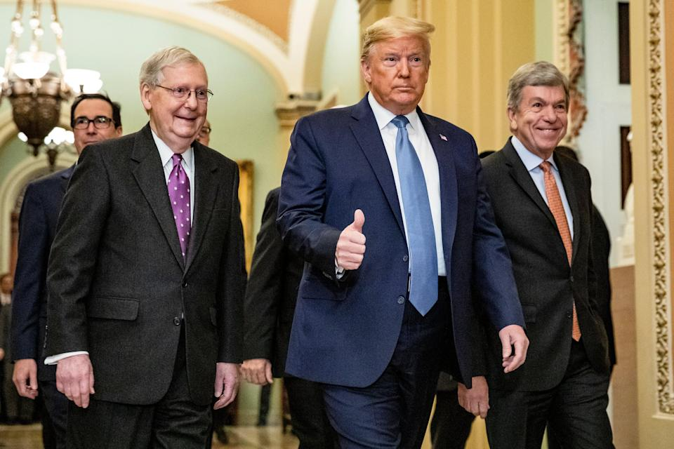 <p>File Image: US President Donald Trump arrives at the US Capitol with Mitch McConnell (left) to attend the Republicans' weekly policy luncheon in March 2020</p> (Getty Images)