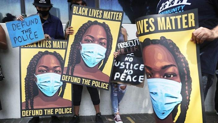 Black Lives Matter-Los Angeles supporters protest outside the Unified School District headquarters calling on the board of education to defund school police on June 23, 2020 in Los Angeles, California. The demonstrators want the funds currently spent on campus police to be reallocated to other student-serving priorities. (Photo by Mario Tama/Getty Images)