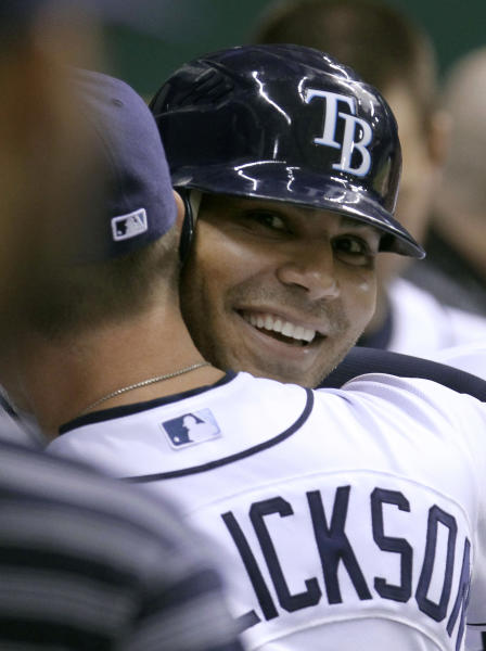 Tampa Bay Rays' Carlos Pena hugs teammate Jeremy Hellickson after Pena's sixth-inning home run off Los Angeles Angels starting pitcher Ervin Santana during a baseball game Tuesday, April 24, 2012, in St. Petersburg, Fla. The hit was Pena's 1,000th of his career. (AP Photo/Chris O'Meara)