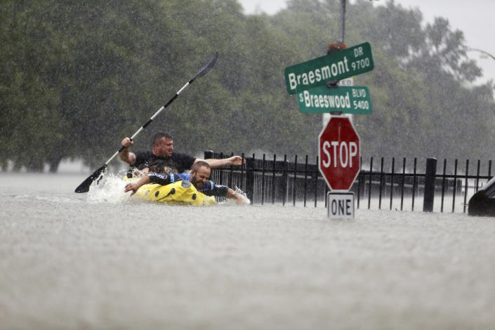 <p>Two kayakers try to beat the current pushing them down an overflowing Brays Bayou from Tropical Storm Harvey in Houston, Texas, Sunday, Aug. 27, 2017. (Photo: Mark Mulligan/Houston Chronicle via AP) </p>