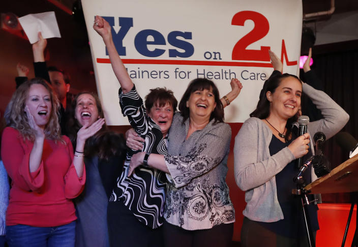 Robyn Merrill, co-chair of Mainers for Health Care, second from the left, celebrates her victory with fellow supporters of Medicaid expansion, in Portland, Maine, in November last year. (Photo: Robert F. Bukaty,/AP)