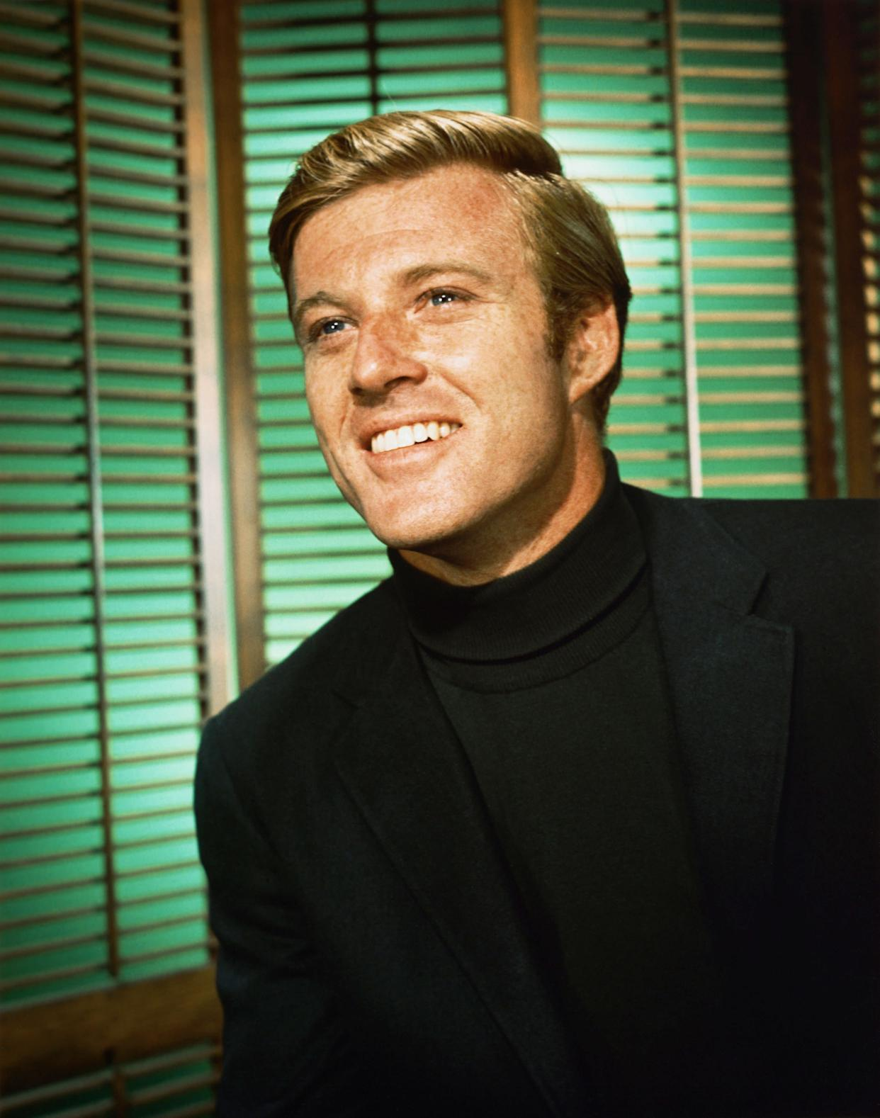 The actor smiling in a turtleneck, circa 1960.
