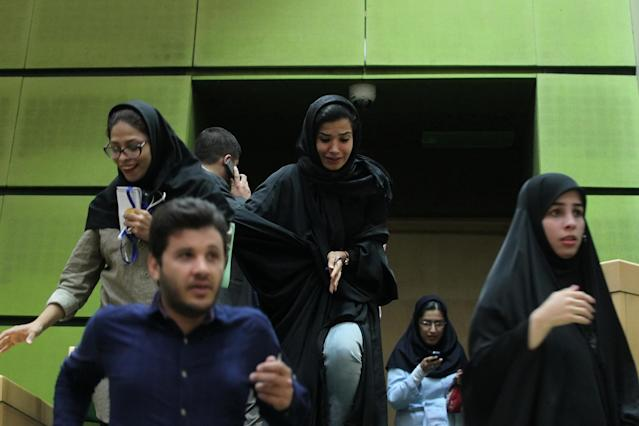 <p>Women are seen inside the parliament during an attack in central Tehran, Iran, June 7, 2017. (Photo: TIMA via Reuters) </p>