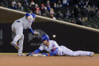 New York Mets second baseman Jeff McNeil (6) misses the throw allowing Chicago Cubs Willson Contreras (40) to make it safely to second during the fifth inning of a baseball game Wednesday, April 21, 2021, in Chicago. (AP Photo/Mark Black)