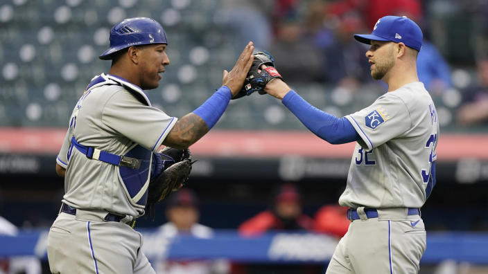 Kansas City Royals relief pitcher Jesse Hahn, right, is congratulated by catcher Salvador Perez after a baseball game against the Cleveland Indians, Monday, April 5, 2021, in Cleveland. (AP Photo/Tony Dejak)