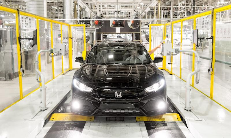 A Honda Civic sedan moves down an assembly line at Honda's assembly plant in Swindon, U.K.