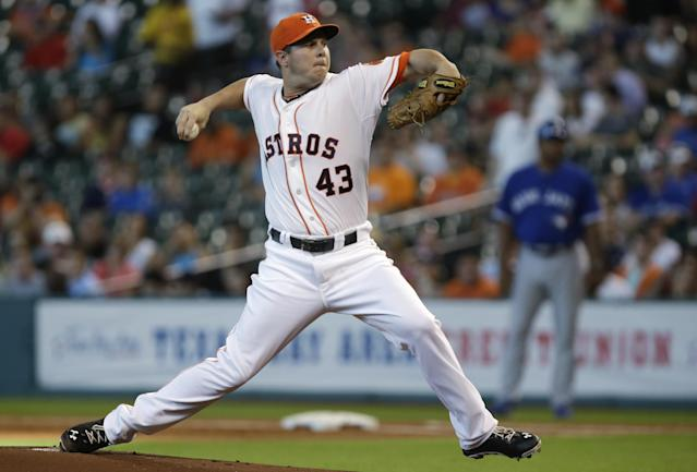 Houston Astros' Brad Peacock delivers a pitch against the Toronto Blue Jays in the first inning of a baseball game Saturday, Aug. 24, 2013, in Houston. (AP Photo/Pat Sullivan)