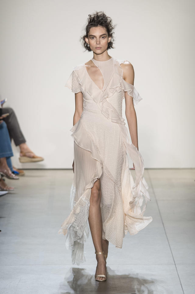 <p><i>Model wears a sheer ruffled dress from the SS18 Jonathan Simkhai collection. (Photo: ImaxTree) </i></p>