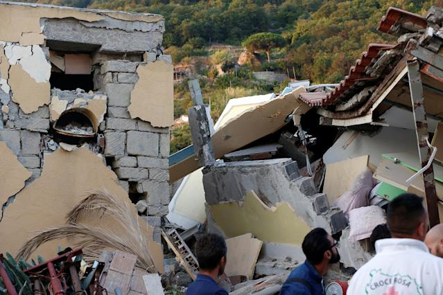 <p>Collapsed houses are seen after an earthquake hits the island of Ischia, off the coast of Naples, Italy, Aug. 22, 2017. (Photo: Ciro De Luca/Reuters) </p>