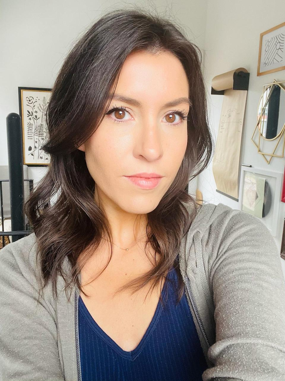 """<p>When I woke up, my hair looked smoother, but my roots were still a smidge uneven in volume. I figured the best way to level out the playing field was to add a few waves with my favorite <a href=""""https://www.t3micro.com/product/curl-id-curling-iron"""" class=""""link rapid-noclick-resp"""" rel=""""nofollow noopener"""" target=""""_blank"""" data-ylk=""""slk:T3 Curl ID Smart Curling Iron"""">T3 Curl ID Smart Curling Iron</a> ($235). </p> <p>Strangely I still felt that, despite the majority of my hair no longer living on the right side of my face, I still slanted my head for a selfie toward the right. I guess relearning my angles for middle part-dom is something TikTok will have to teach me, too. </p>"""