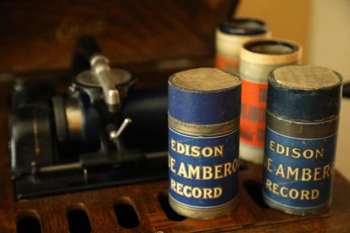 SANTA BARBARA, CA - NOVEMBER 10, 2020 - Four Edison Blue Amberol cylinder records, right, can be played on a Edison Amberola phonograph, background, in the home of David Seubert, curator for Performing Arts Collection at UC Santa Barbara Library, in Santa Barbara on November 10, 2020. Seubert runs the Cylinder Audio Archive at the university and under his guidance, 10,000 of these cylinders, the oldest commercial music formate, have been digitized and made available for streaming and download. The Cylinder Audio Archive is a free digital collection maintained by the University of California, Santa Barbara Library with streaming and downloadable versions of over 10,000 phonograph cylinders manufactured between 1893 and the mid-1920s. (Genaro Molina / Los Angeles Times)