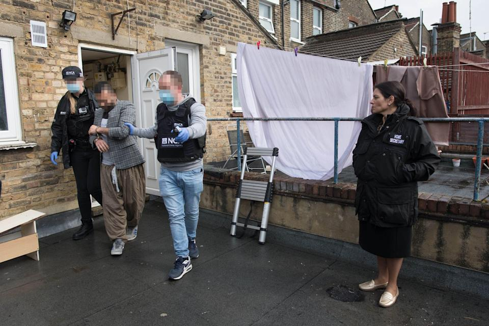 <p>The home secretary accompanied officers on the raids in east London</p> (PA)