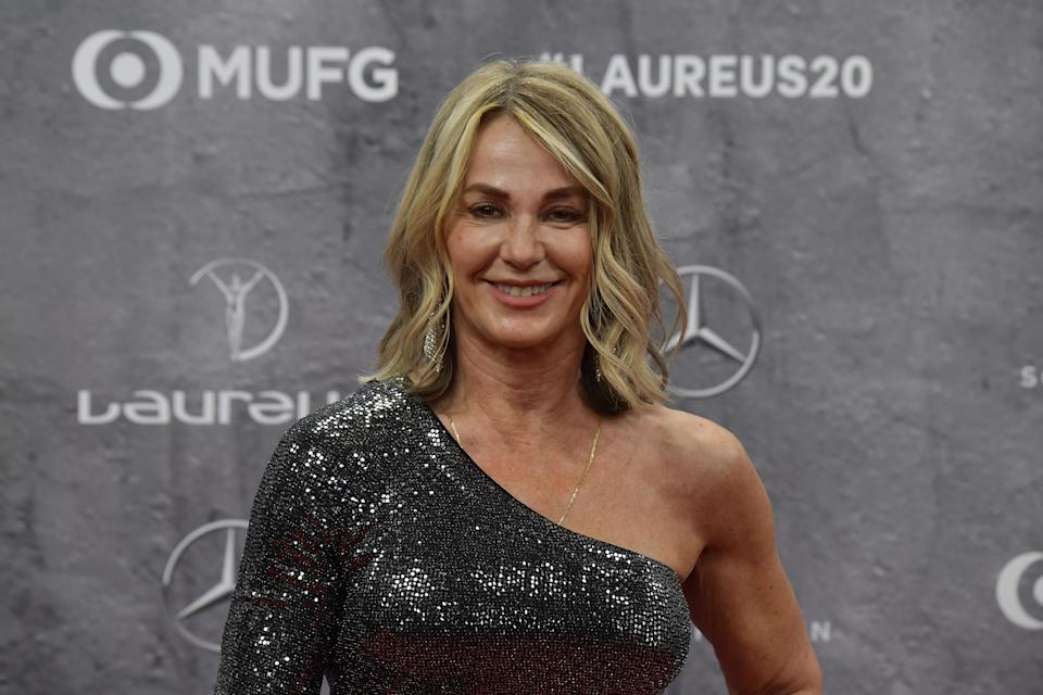 Laureus Academy member Nadia Comaneci poses on the red carpet prior to the 2020 Laureus World Sports Awards ceremony in Berlin on February 17, 2020. (Photo by Tobias SCHWARZ / AFP) (Photo by TOBIAS SCHWARZ/AFP via Getty Images)