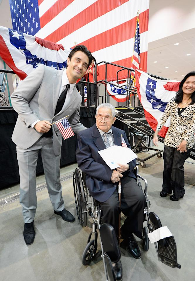 Actor Gilles Marini from France (L) and the oldest candidate to become a U.S. citizen 102 year-old Joaquin Arciago Guzman, from Philippines, hold up their citizenship certificates after a naturalization ceremony at the Los Angeles Convention Center on June 27, 2012 in Los Angeles, California. More than 7,000 candidates became citizens representing more than 120 countries among them a and the   (Photo by Kevork Djansezian/Getty Images)