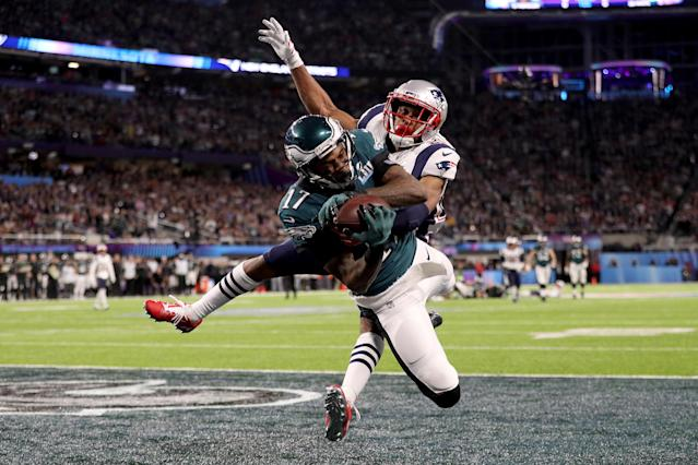 <p>Alshon Jeffery #17 of the Philadelphia Eagles catches a 34 yard pass, over Eric Rowe #25 of the New England Patriots, for a touchdown during the first quarter in Super Bowl LII at U.S. Bank Stadium on February 4, 2018 in Minneapolis, Minnesota. (Photo by Patrick Smith/Getty Images) </p>