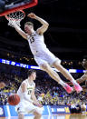 <p>Ignas Brazdeikis #13 of the Michigan Wolverines dunks the ball against the Florida Gators during the first half in the second round game of the 2019 NCAA Men's Basketball Tournament at Wells Fargo Arena on March 23, 2019 in Des Moines, Iowa. (Photo by Andy Lyons/Getty Images) </p>