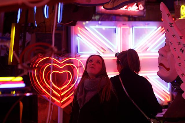 <p>Visitors look at the neon signs and artworks in God's Own Junkyard gallery and cafe in London, Britain, March 31, 2017. (Photo: Russell Boyce/Reuters) </p>