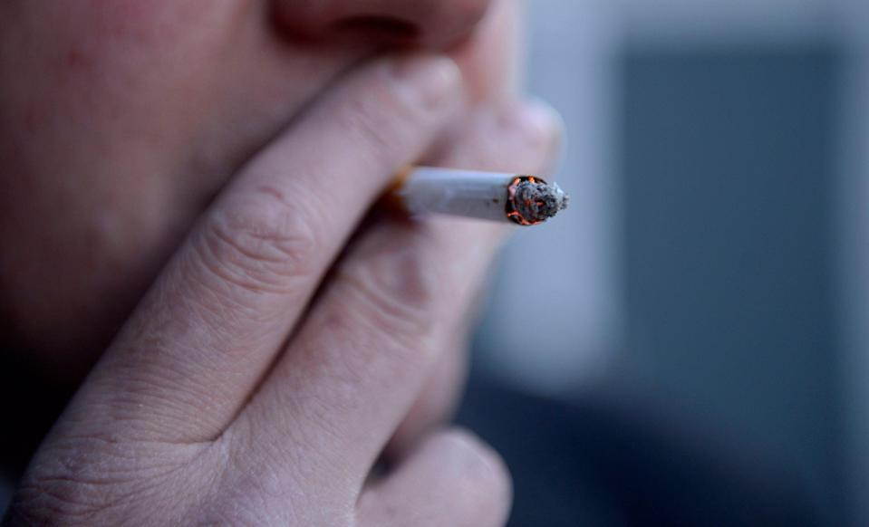 <p>File photo dated 12/03/13 of a man smoking a cigarette.</p> (PA)